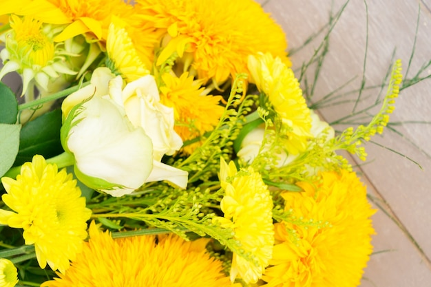 Yellow fall bouquet on gray wooden table close up