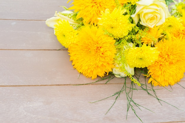 Yellow fall bouquet on gray wooden table with copy space