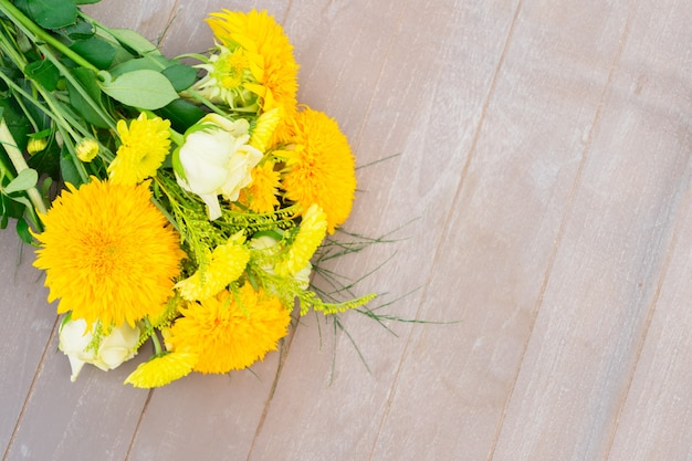 Yellow fall bouquet on gray wooden table