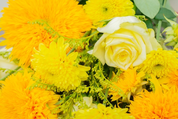 Yellow fall bouquet of vibrant flowers close up