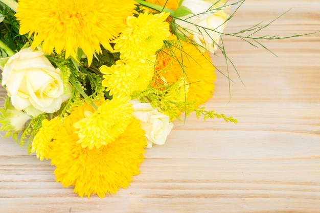 Yellow fall bouquet on wooden table with copy spacebackground