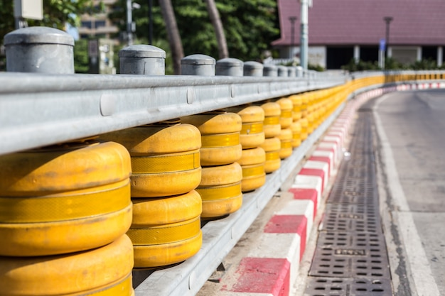 Yellow fences on curve of the road in thailand