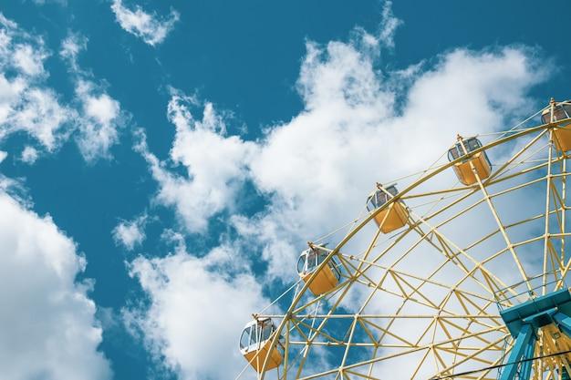 Yellow ferris wheel under the blue sky