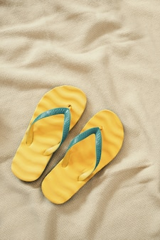 Yellow flip flops, summer vacation concept