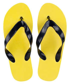 Yellow flip flops on white background the view from the top