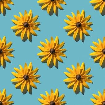 파란색 배경에 노란색 꽃입니다. 완벽 한 패턴입니다. 꽃 배경입니다.