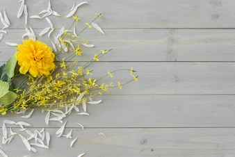Yellow flowers on grey wooden desk