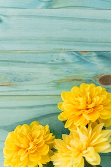 Yellow flowers on yellow tabletop