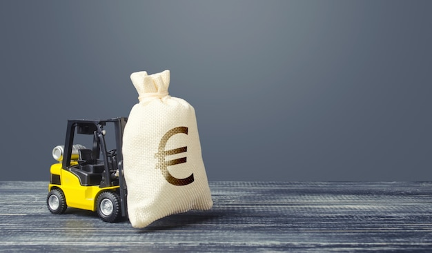 Yellow forklift carries a euro money bag.