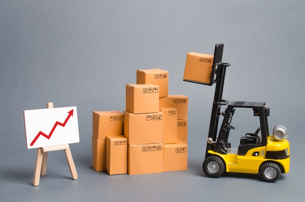 Yellow forklift truck with cardboard boxes and a red arrow up. increase sales, production of goods