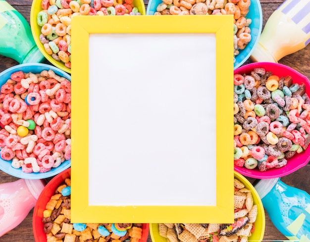 Yellow frame on bright bowls of cereals and bottles