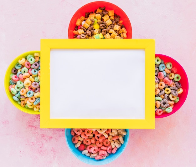 Yellow frame on four bowls of cereals
