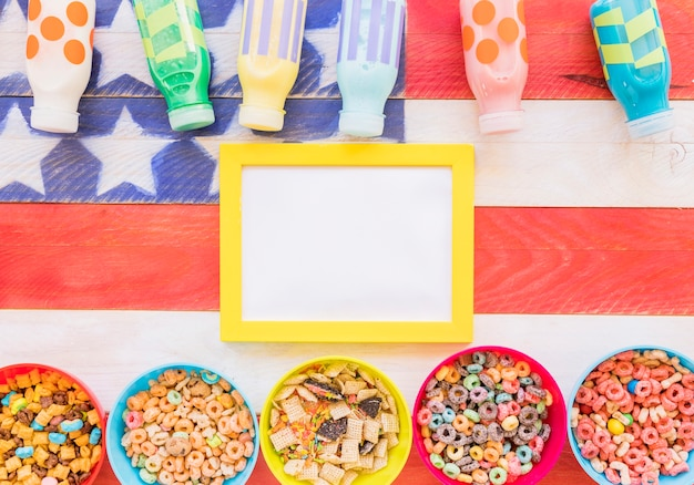 Yellow frame with bowls of cereals and milk