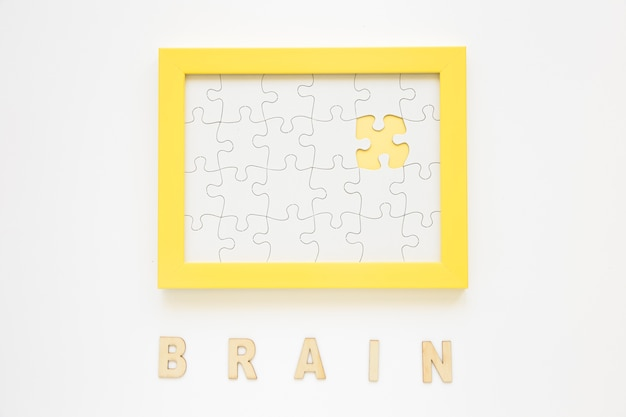 Yellow frame with missing jigsaw piece near brain word