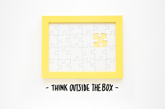 Yellow frame with missing jigsaw piece near think outside the box text