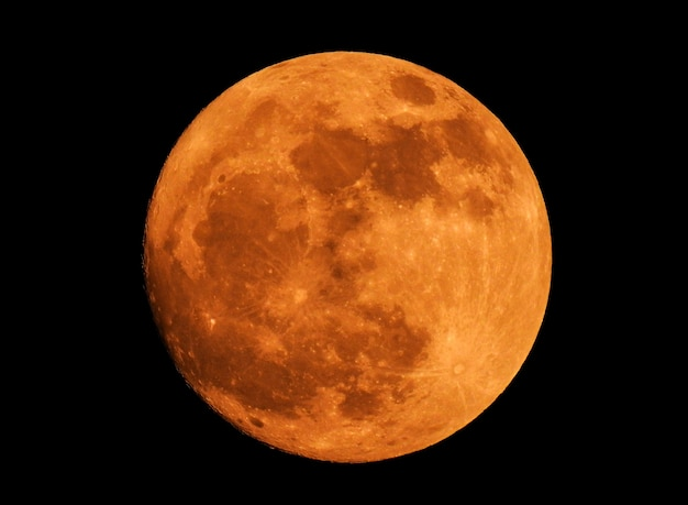 The yellow full moon on black background