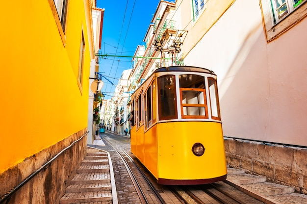 Yellow funicular on the railway in lisbon, portugal. famous travel destination