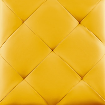 Yellow genuine leather upholstery background.