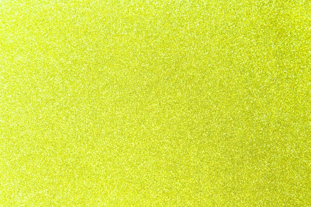 Желтый блеск блестящей текстуры фона