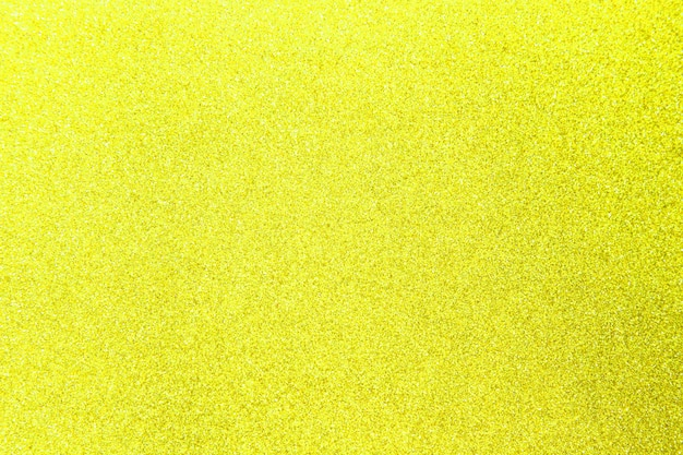 Yellow glitter shiny texture for christmas, celebration concept.