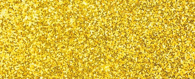 黄色のキラキラテクスチャ。バナーの背景。新年、クリスマスの装飾、お祝いのための非常に詳細なマクロの抽象的なキラキラライト。グラフィックデザインコンセプト写真