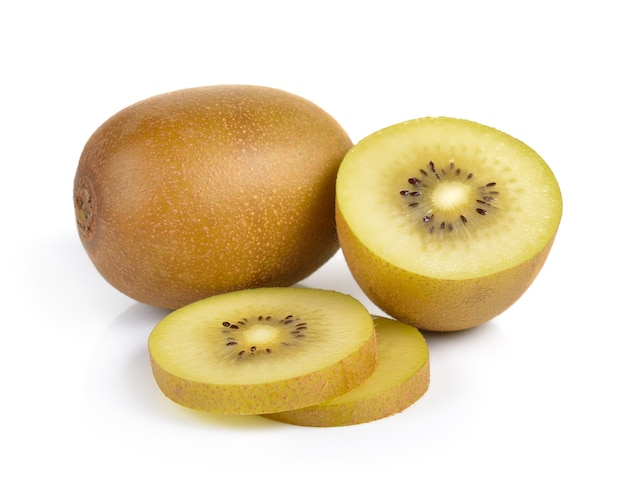 Yellow gold kiwi fruit on a white wall