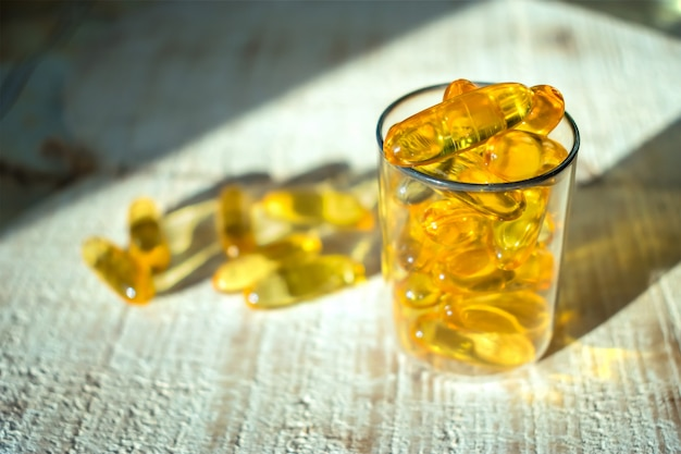 Yellow gold oil vitamin, omega 3 capsules