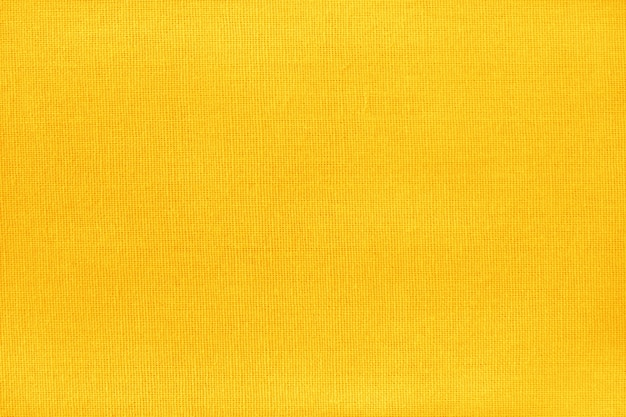シームレスパターンの黄色の黄金綿生地のテクスチャです。