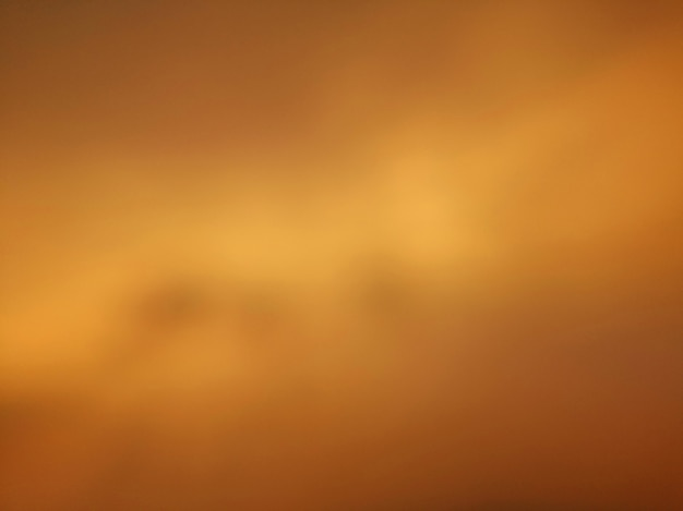 Yellow golden tone abstract blurred sky background