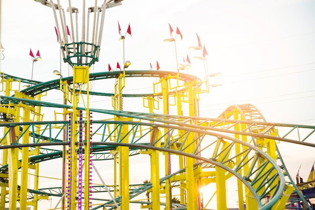 Yellow and green colored roller coaster ride