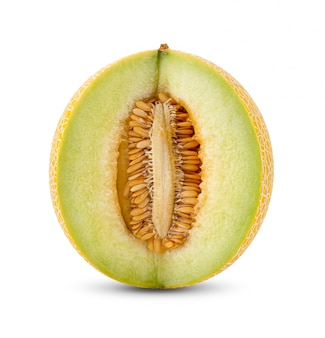 Yellow half cantaloupe melon on white wall.