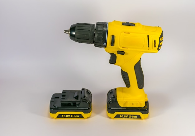 Yellow hand-held cordless screwdriver for professional work.