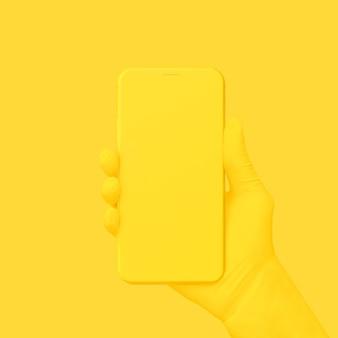 Yellow hand holding phone on yellow.