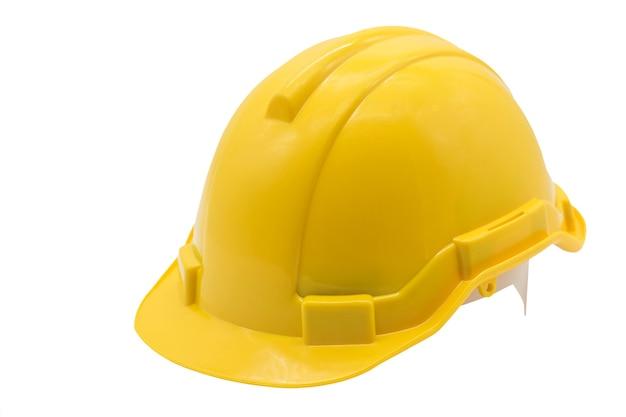 Желтая каска или шлем, изолированные на белом фоне. промышленные рабочие или концепция оборудования безопасности строительной площадки.
