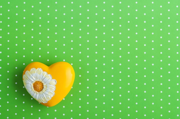 Yellow heart on green polka dotted