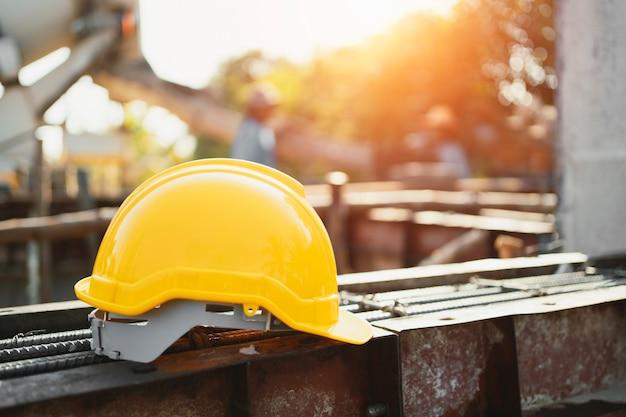 Yellow helmet on steel in construction site