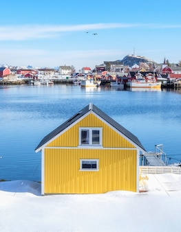 Yellow house on snow in fishing village
