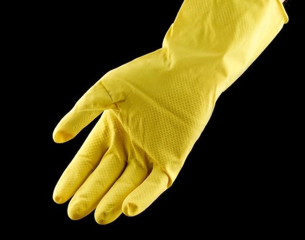 黄色の家庭用ミトン Premium写真