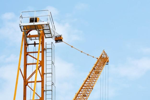Yellow industrial construction cranes