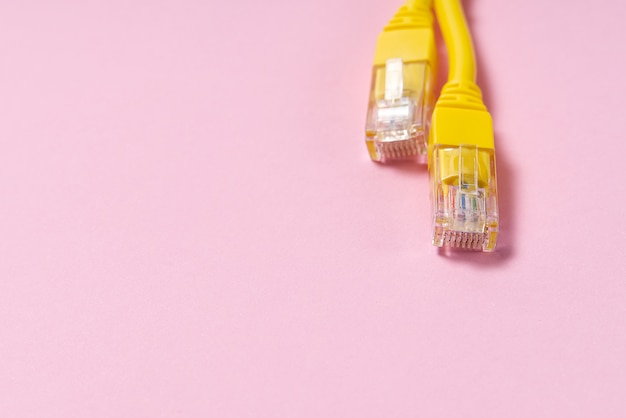 Yellow internet wire on pink background