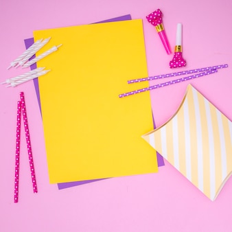 Yellow invitation with girly birthday supplies