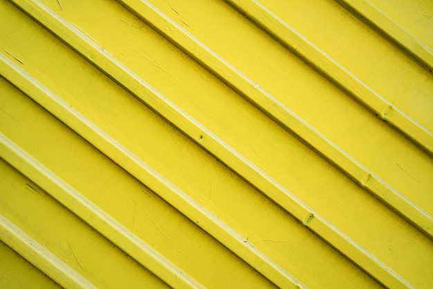 Yellow iron tin fence lined background. metal texture