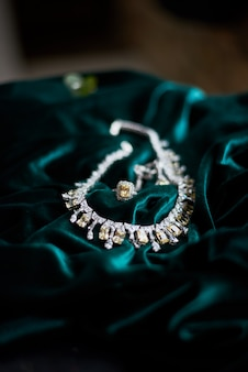 Yellow jewels necklace brilliant on dark green velvet