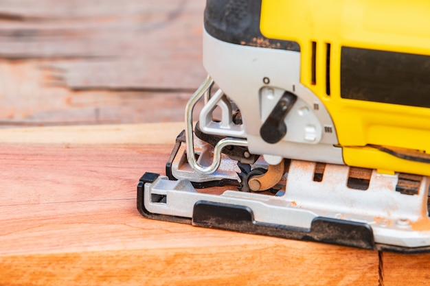 The yellow jigsaw for wood working.