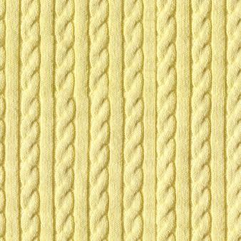 Yellow knitted sweater handmade with braids