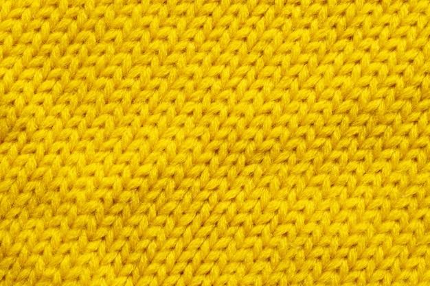 노란색 뜨개질 양모 질감 배경