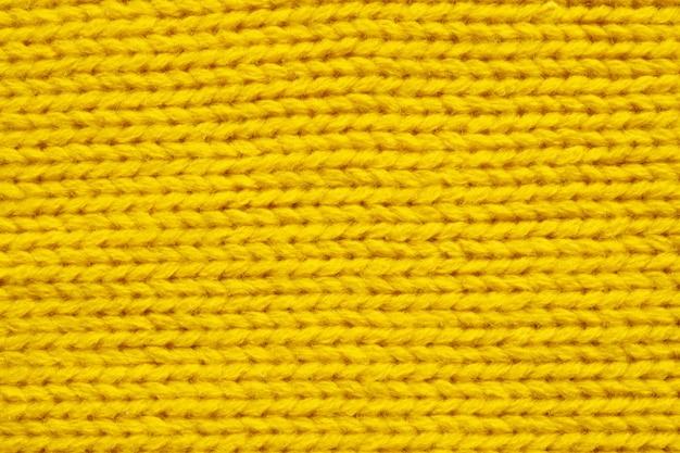 黄色の編みウールの質感