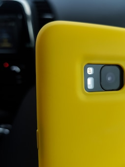 Yellow layout of the phone case smartphone in a yellow plastic case rear view