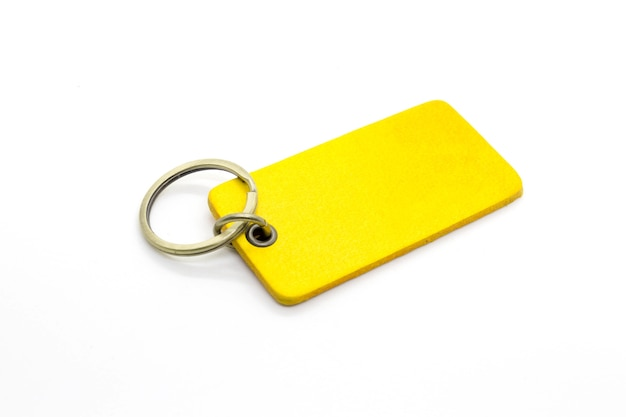 Yellow leather keychains on white background