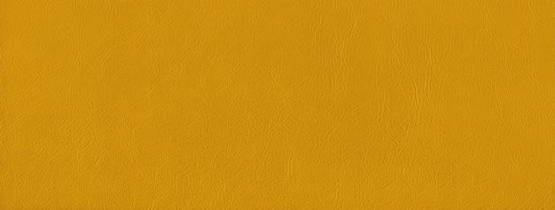 黄色の革テクスチャ背景。天然素材。